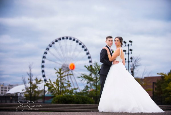 bride and groom before ferris wheel in chicago on their wedding day