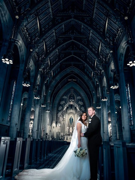 Couple on their wedding day at the beautiful church in Chicago with amazing cathedral ceilings in the background