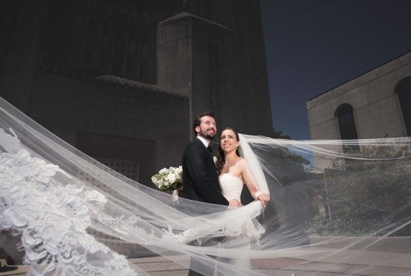 wedding photograph with brides veil flying in the wind
