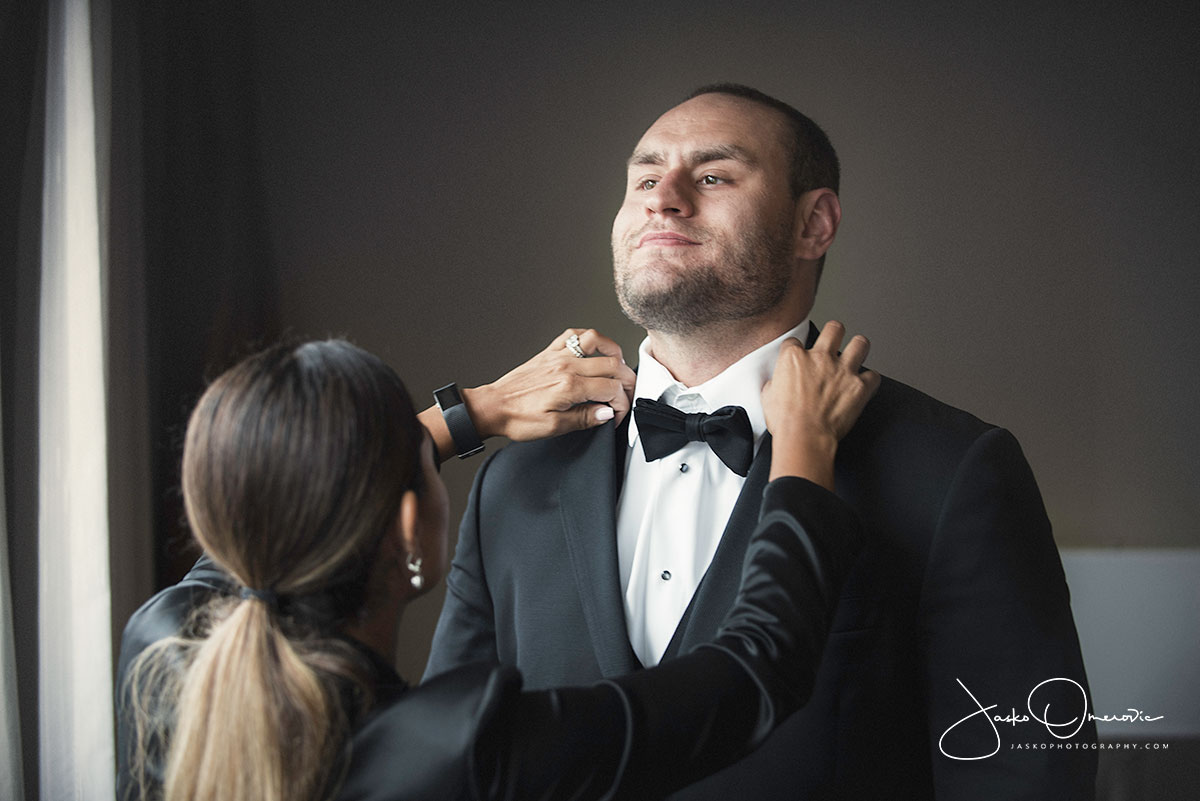 chicago wedding planner helping groom get ready for the wedding