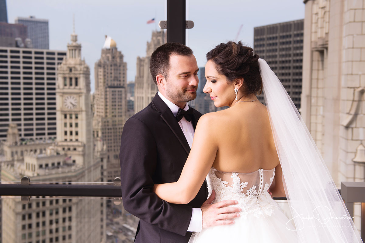 bride and groom rooftop portrait at royal sonesta chicago
