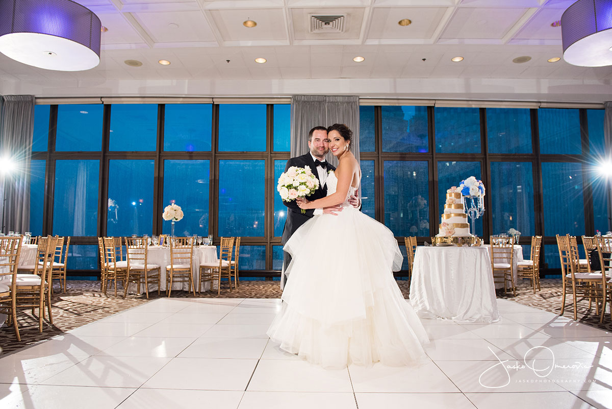 bride and groom in the empty ballroom at royal sonesta chicago