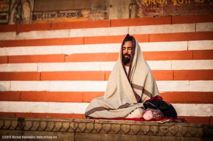 Man meditating on the banks of the Ganges.