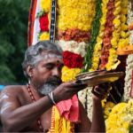 Priest in South India with offerings