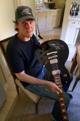 Joe Bonamassa signing his Gibson Les Paul to give to Jason Becker