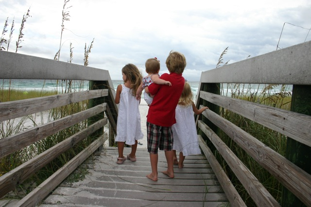(all four looking out at the water)