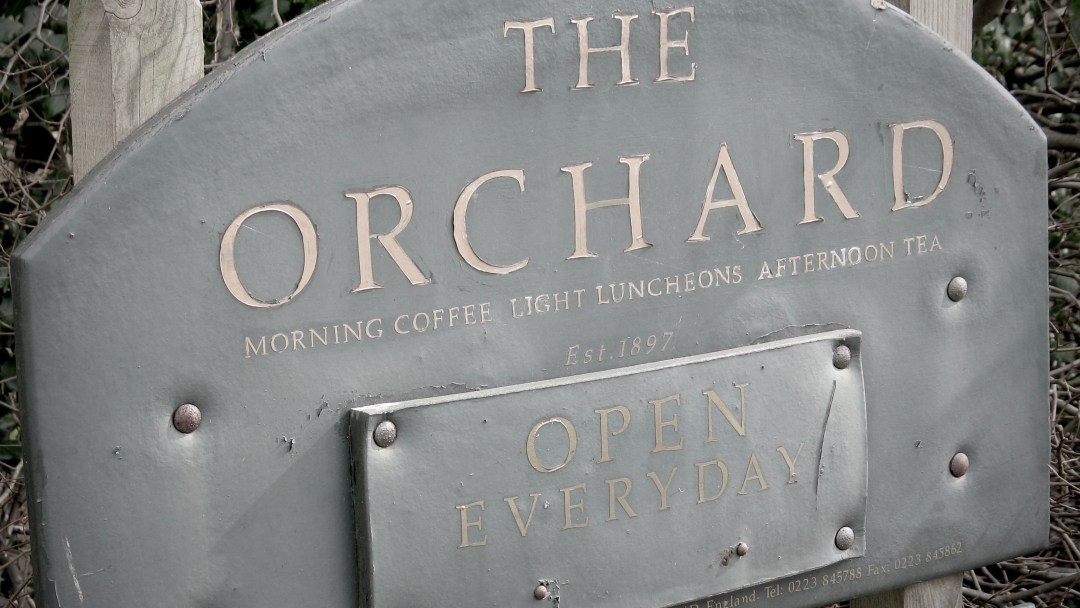 orchard sign with paint peeling