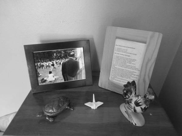 Turtle from Nancy Hamilton; photo by Reuben Radding; crane from Irene Jaglowski; chicken from Gina Thompson; Buddhist precepts framed by me.