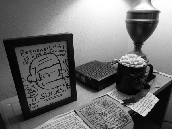 Self-portrait by Gregg Lion-Hands Symons; mug and candle from Jenn Weinzerl-Binus