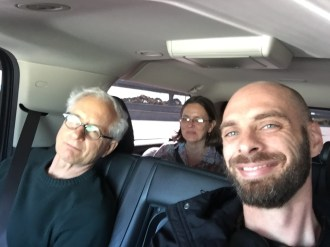 In the car with Alan and Maria.