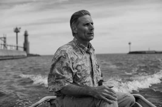 Pete Neerdaels, my step-dad, piloting his jon boat into harbor from Lake Michigan in Algoma, WI, 2010