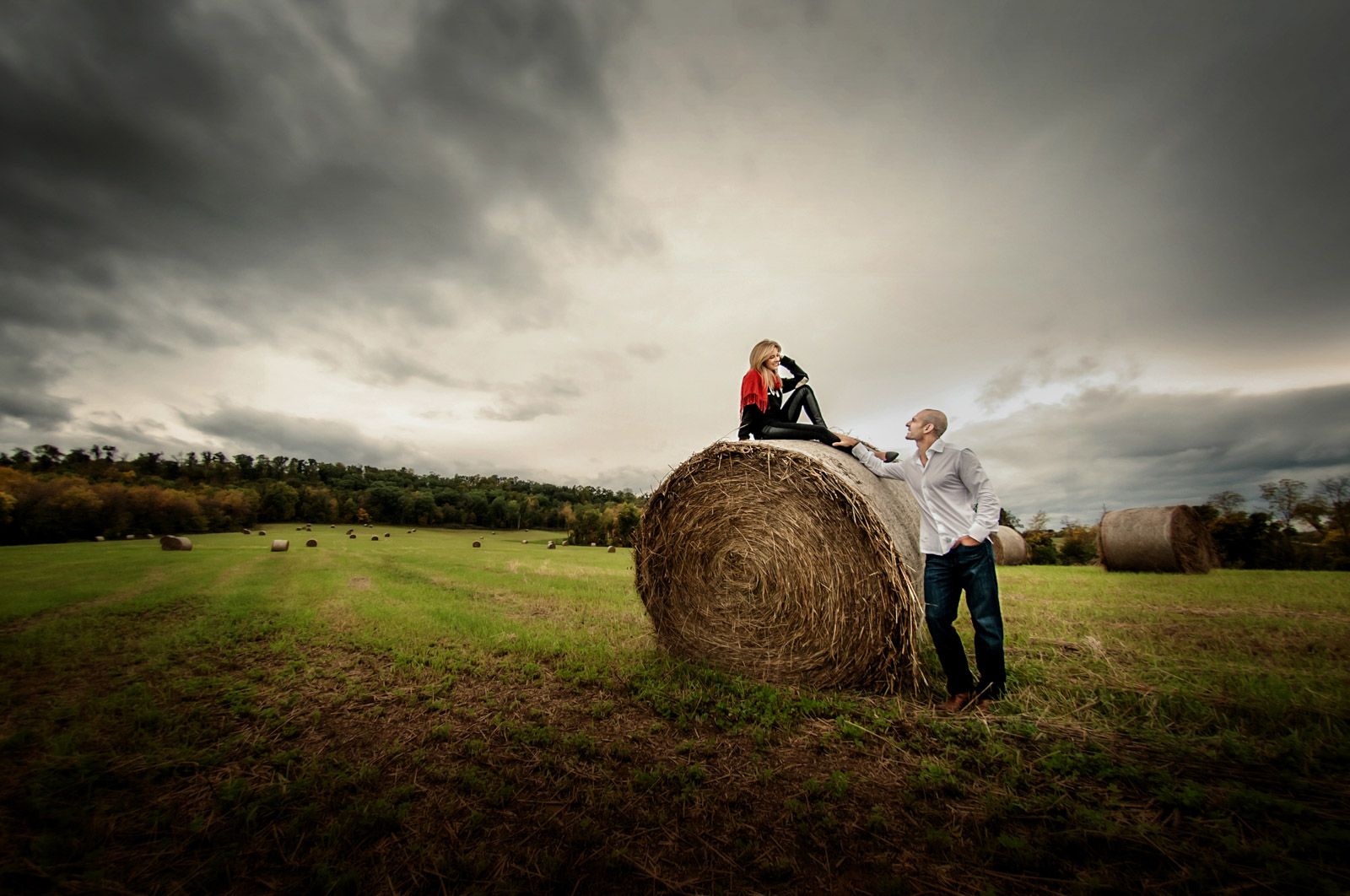 Engagement Session on a bale of hay in a country field