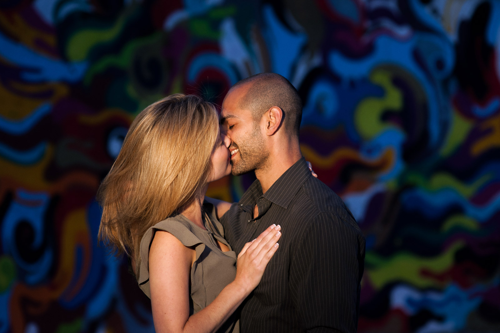 Engagement Session shot in Pilsen in front of street art and urban graffiti