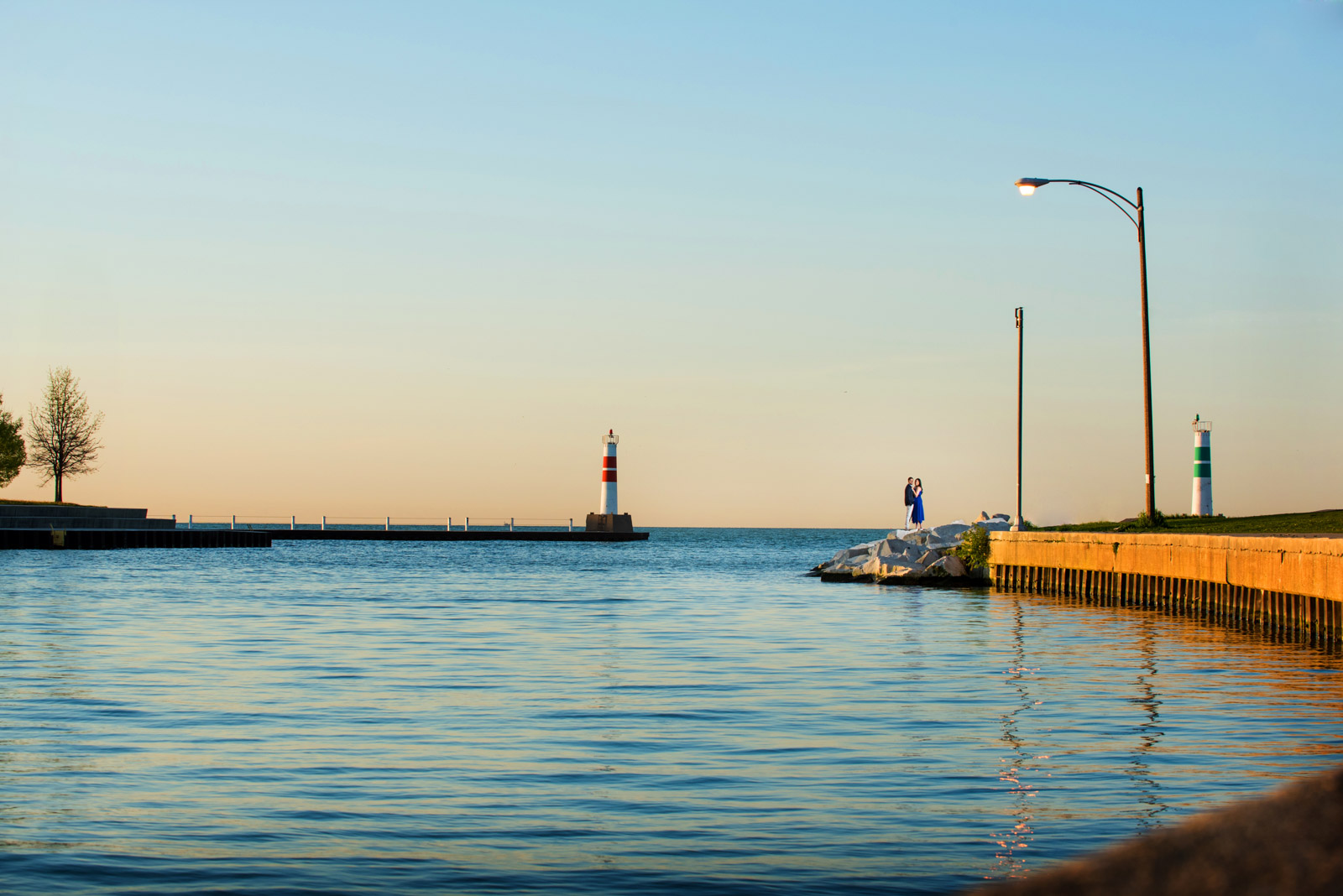 Engagement session photo captured on Lake Michigan at Montrose Harbor