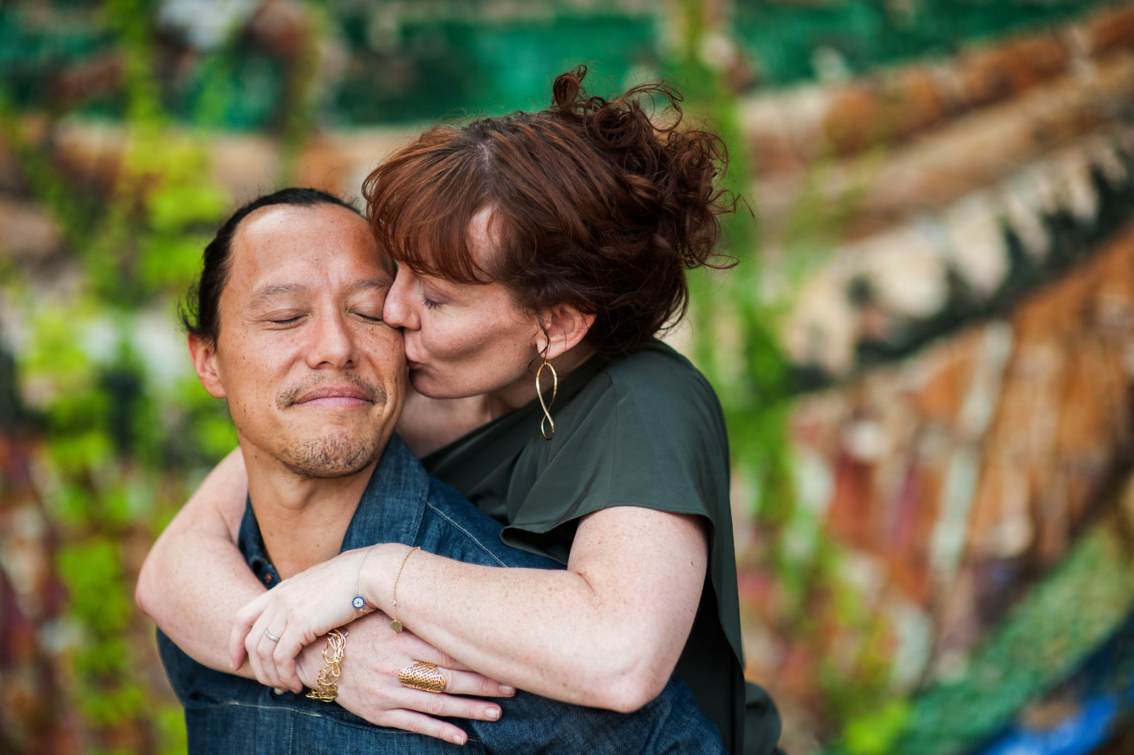 woman kissing man wrapping arms around him