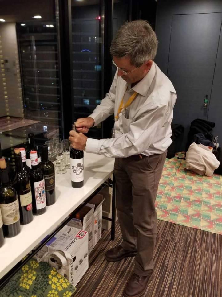 Louis Roos, wine maker at Mooiplaas Estate in Stellenbosch opens the first bottle of Jason Oliva Wine Octopus 2010 in Japan a bottle he helped create along with Dirk Roos