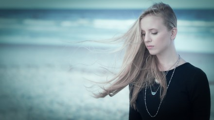 This came from a failed attempt to get her hair blowing sideways. I love the somber feel of this image with the color grading. Photography that evokes a feeling is my favorite.