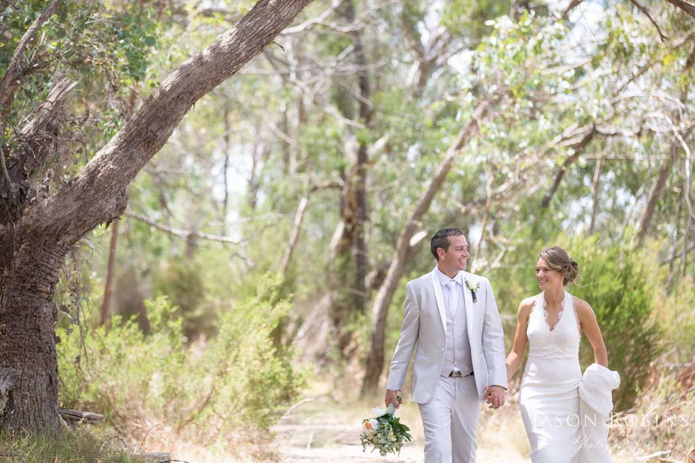 bride and groom walking in bushland near wangaratta Victoria
