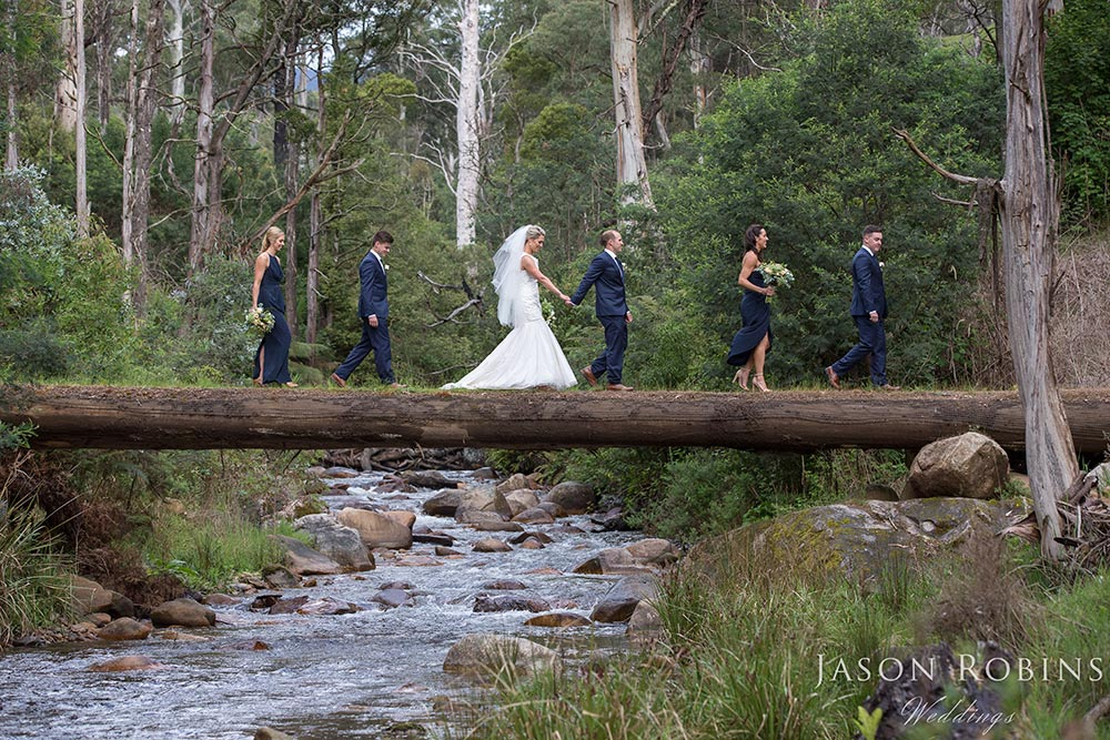 bridal party walking along log bridge at the Delatite River in Victoria