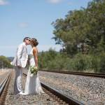 Wedding Photography of groom seeing bride for the first time on railway tracks