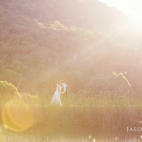Bride and Groom by high country lagoon at sunset