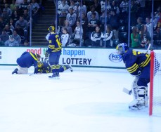 Midway through the first period, sophomore forward JT Compher could not get up after taking a hard hit to the head. Compher is one of Michigan's key players, scoring 7 goals in the Wolverines' last 4 games. Teammate Tyler Motte nervously looks on at Compher.