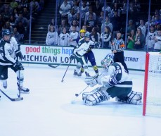 Hildebrand, once again, picked up his game after allowing a goal and stonewalls a Michigan player with his stick.
