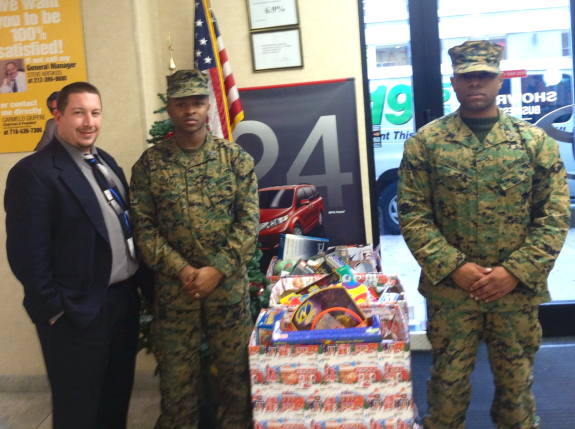Jason Schroeck, Social Media & Web Manager at Toyota of Manhattan, pictured here with U.S. Marines Sergeant Ceasar and Corporal Hamilton when they picked up our Toys for Tots boxes on Wednesday. — at Toyota of Manhattan.