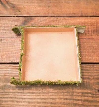 DIY rustic Christmas decor moss wrapped gift box centerpiece tutorial