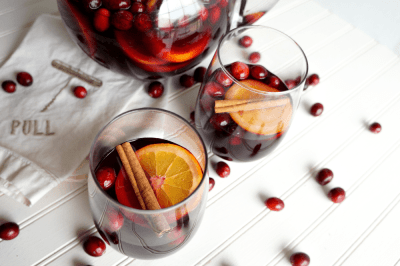 cranberry cocktails for holiday party - spiced cranberry orange sangria in glasses