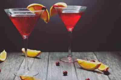 cranberry cocktails for holiday party - cranberry orange infused vodka in glasses