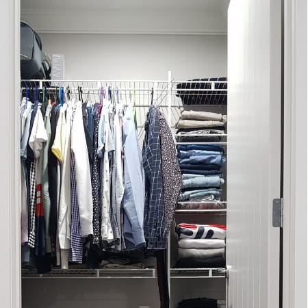 small closet organization with hanging clothes
