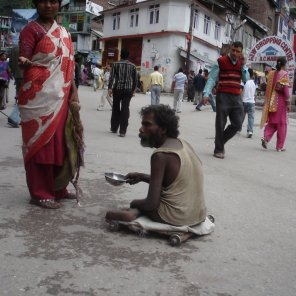 A beggar without legs on the streets of Manali