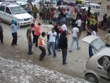 Young men dancing on the road in Rohtang La
