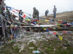 Prayer flags an people in Rohtang La