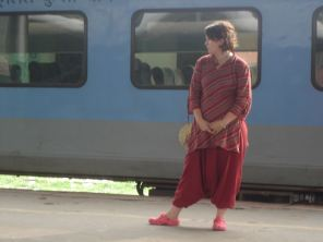 Evelina waiting for our train on the pavement in Kalka