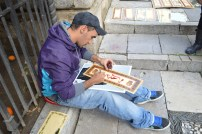 a street artist writing my name in arabic calligraphy