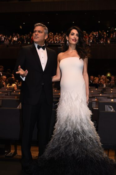 US actor George Clooney (L) and his wife British-Lebanese lawyer Amal Clooney pose as they arrive for the 42nd edition of the Cesar Ceremony at the Salle Pleyel in Paris on February 24, 2017. / AFP / bertrand GUAY (Photo credit should read BERTRAND GUAY/AFP/Getty Images)