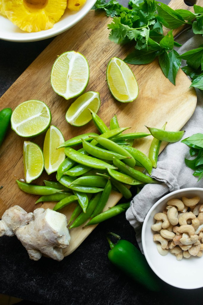 fried rice ingredients  snap peas lime ginger cashews and herbs