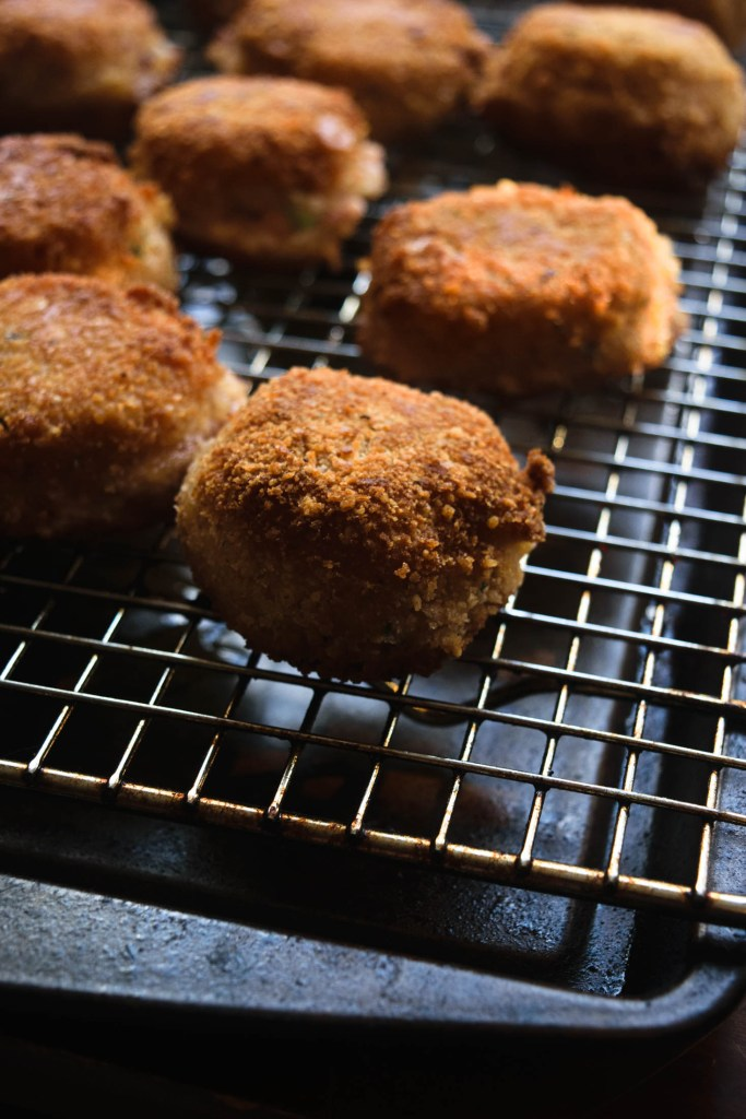 fried ham croquettes cooling on rack