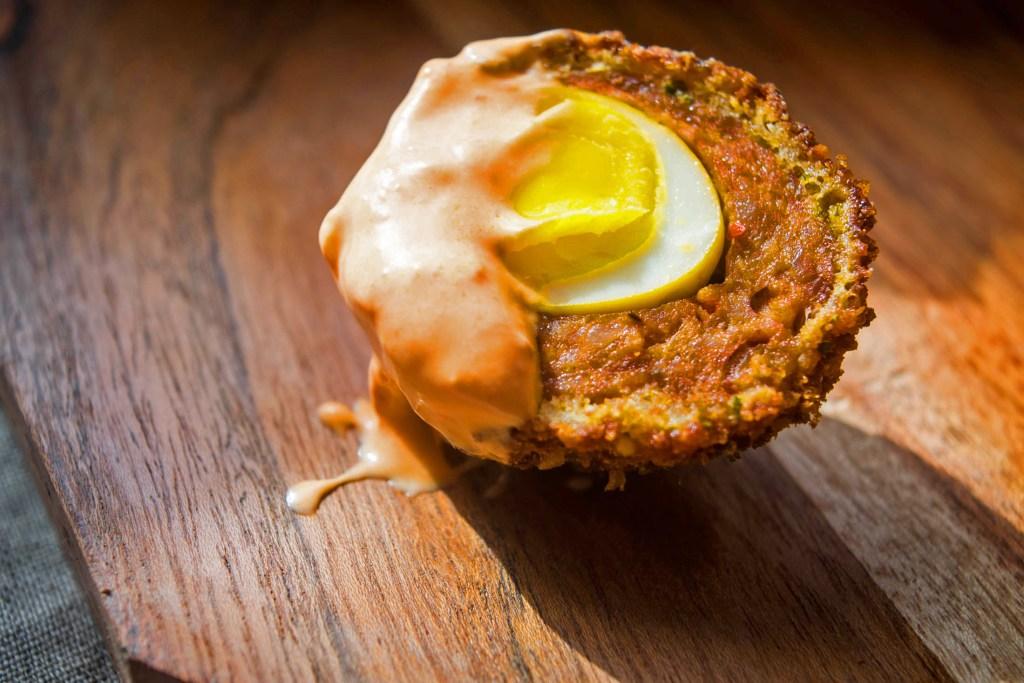 Scotch Quail Eggs with Harissa Cream Sauce
