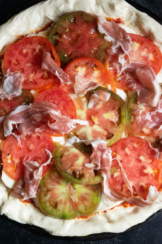 prosciutto layer on pizza