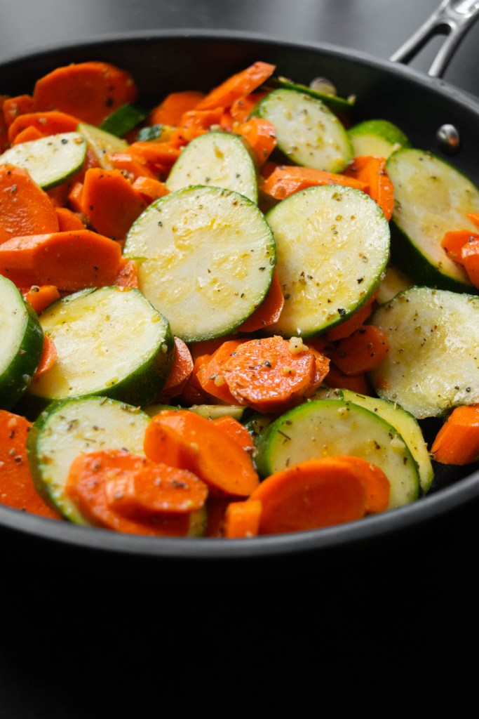 zucchini and carrots in pan