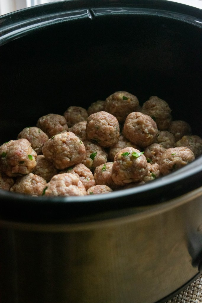 placing meatballs in the crockpot