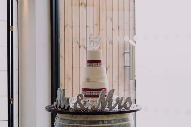 3 tier wedding cake with red & diamanté ribbon
