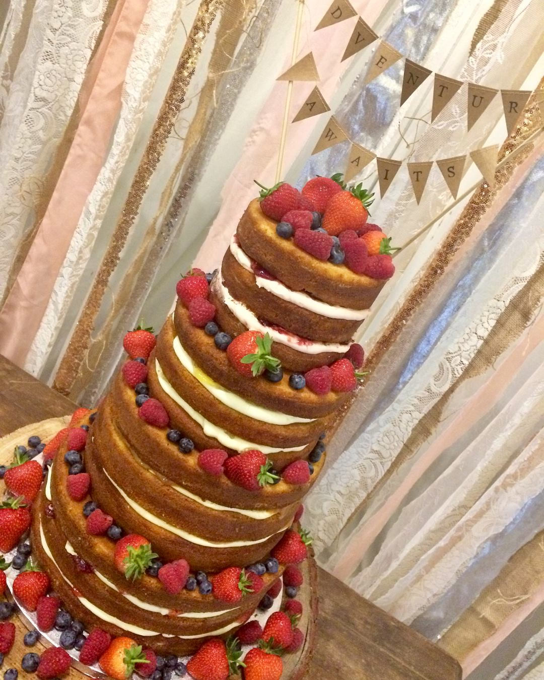 4 tier naked cake with fresh fruit