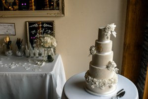 Five tier wedding cake with white sugar roses