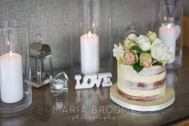 Semi naked wedding cake with fresh rose topper
