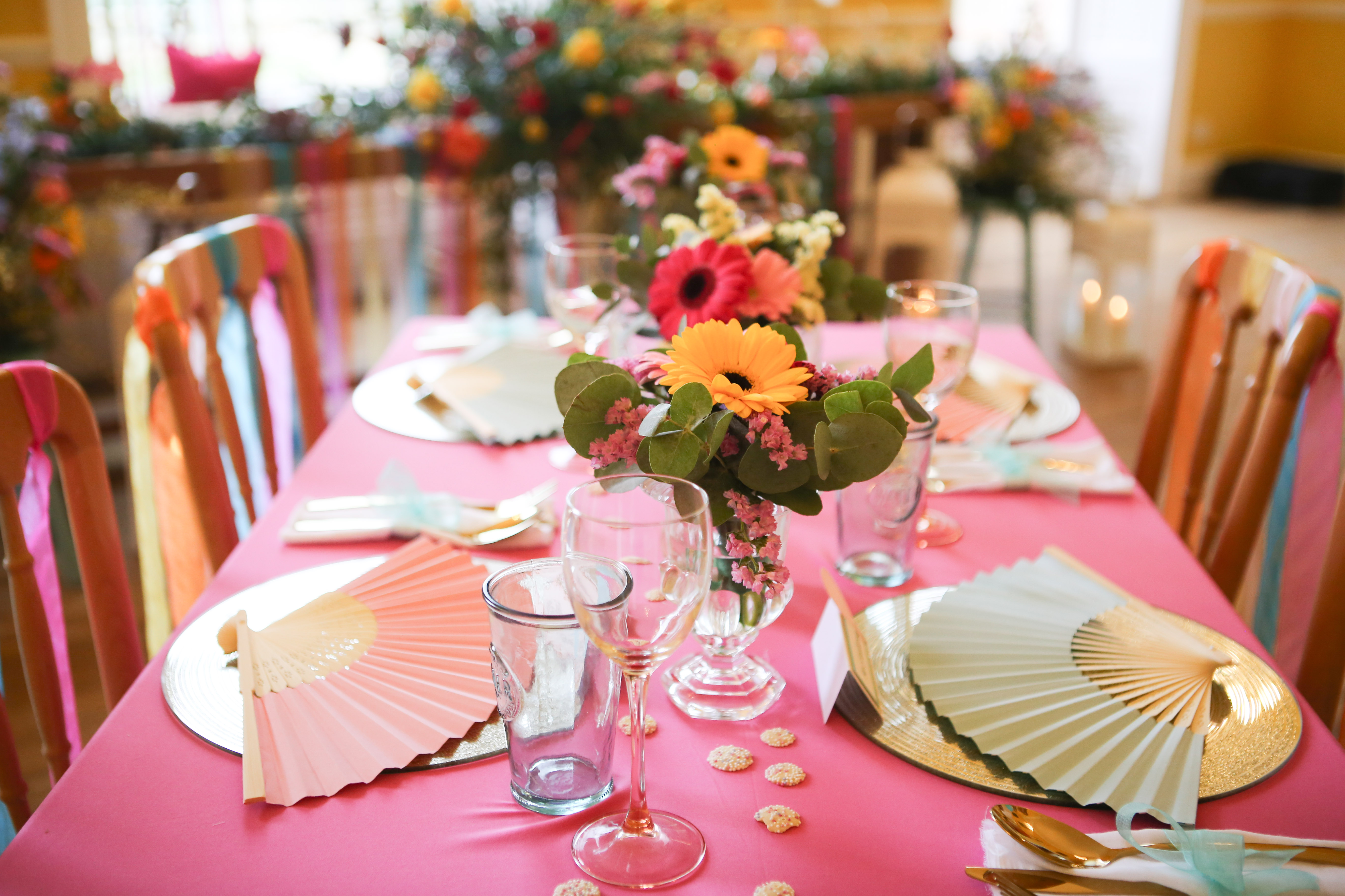 Colourful tablecloths and fans