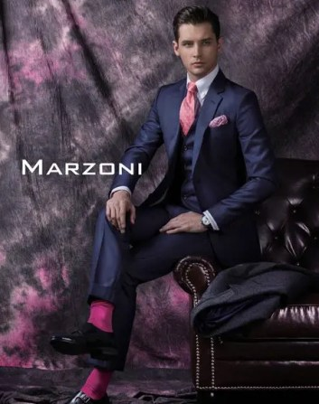 Man wearing a navy suit for Jaxson Maximus suit color guide